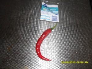 Rode pepers van het balkon